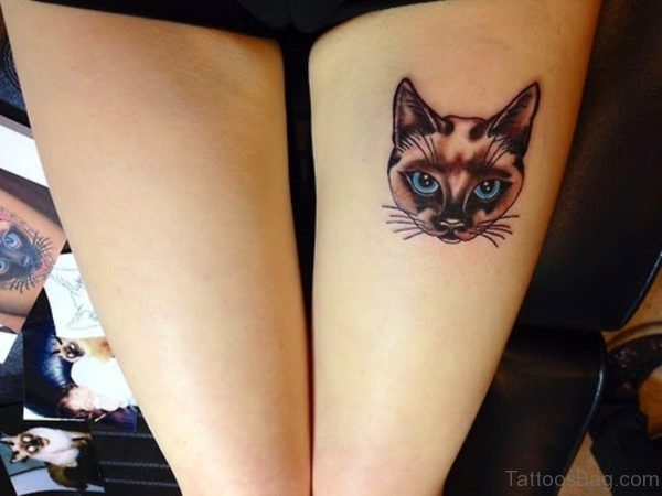 Cat Head Tattoo On Thigh