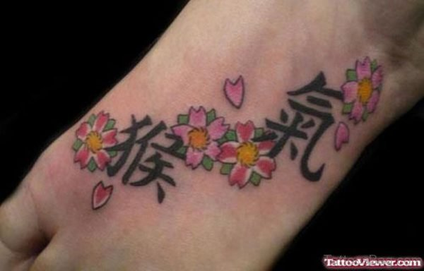 Chinese Letters Tattoo On Foot