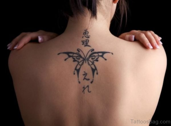 Classic Black Butterfly Tattoo On Upper Back