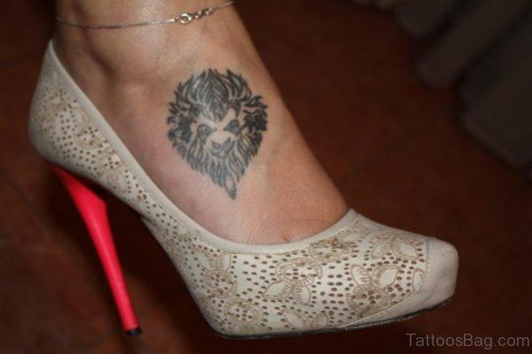 Classy Lion Head Tattoo On Foot