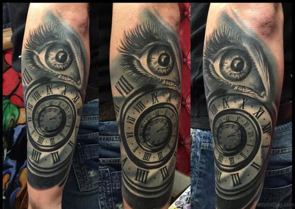 61 mind blowing eye tattoos on arm for Eye with clock tattoo