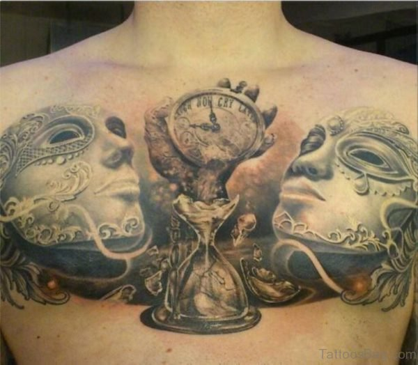 Clock Sandclock And Mask Tattoos On Chest