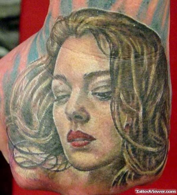 Color Ink Girl Face Tattoo On Hand