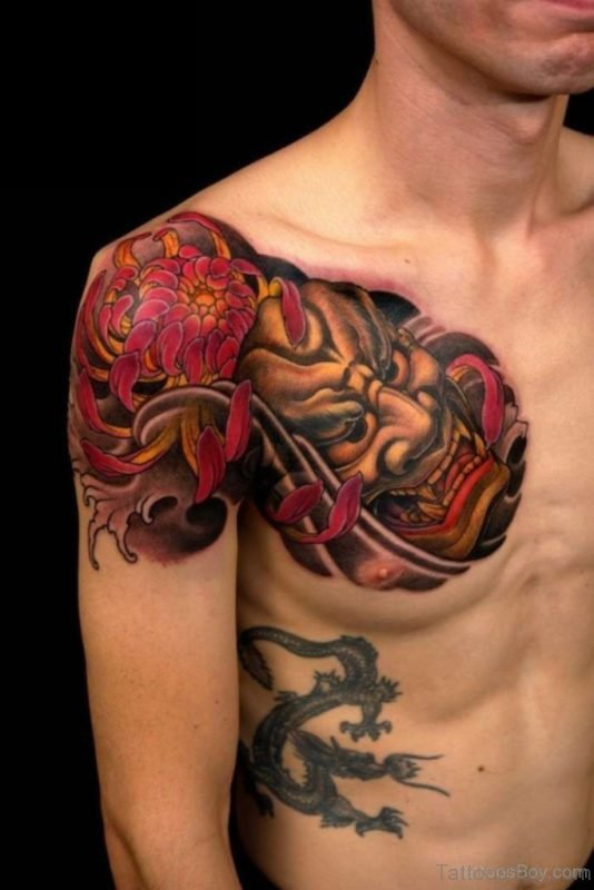 Colored Devil Mask Tattoo On Chest