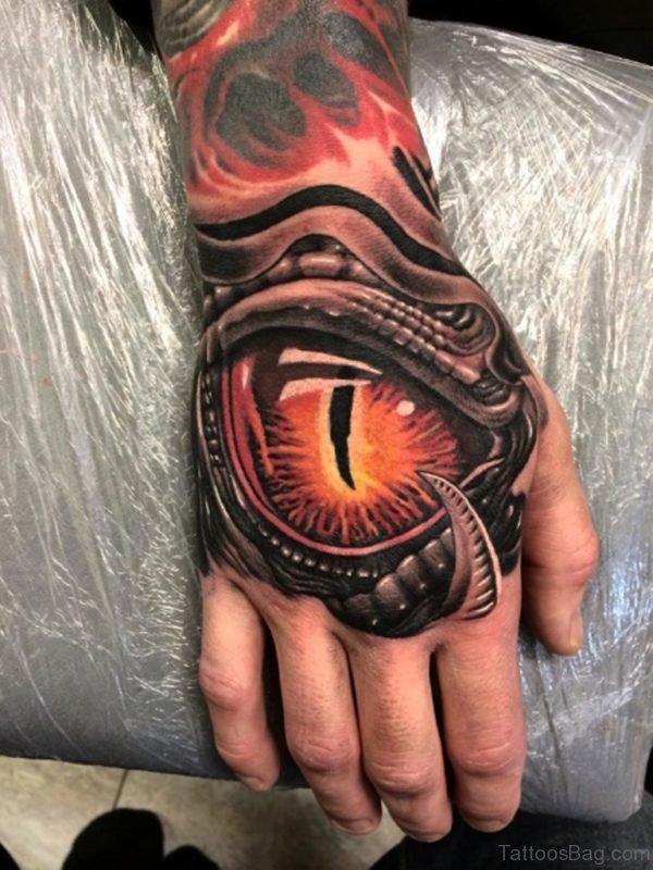Colored Eye Tattoo On Hand