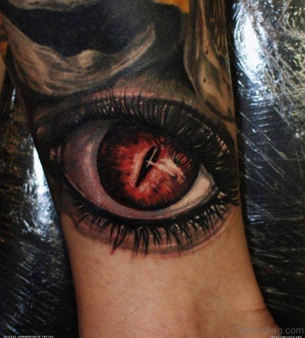 Colored Eye Tattoo On Leg