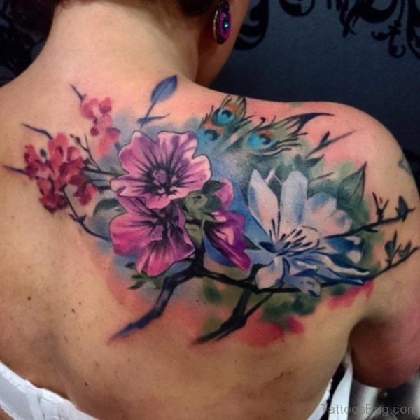 Colored Flowers Tattoo On Upper Back
