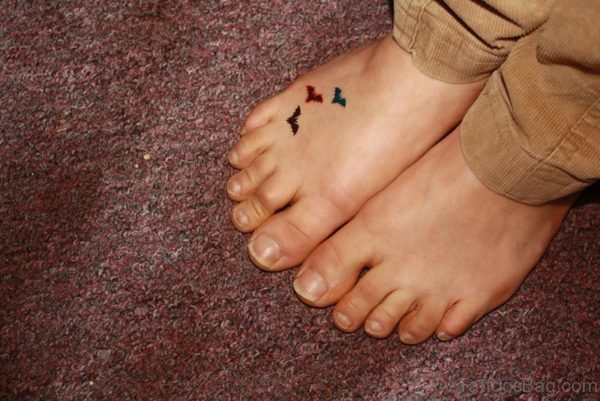 Colored Little Bat Tattoo On Foot