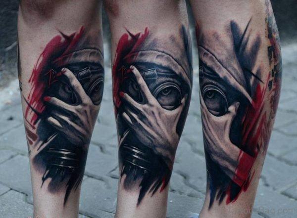 Colorful Gas Mask Tattoo On Leg