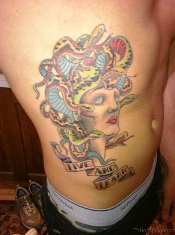 Colorful Medusa Head Tattoo On Rib
