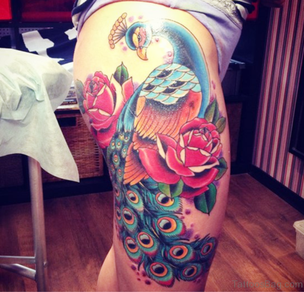Colorful Peacock Tattoo On Thigh