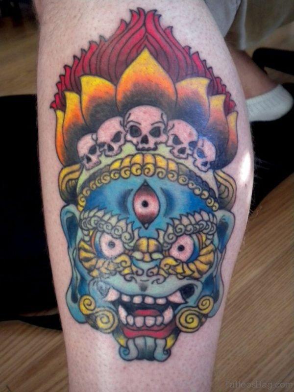Colorful Thai Mask Tattoo On Leg