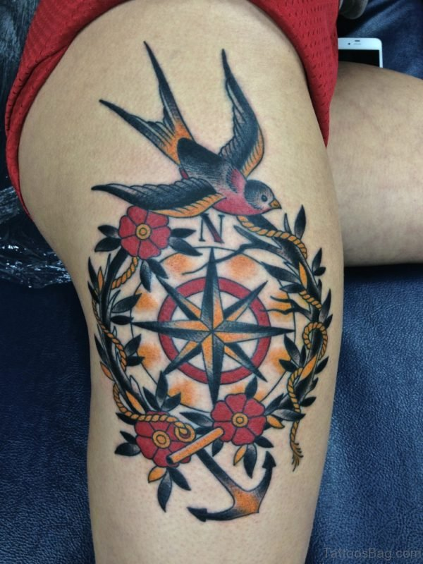 Compass And Bird Tattoo On Thigh