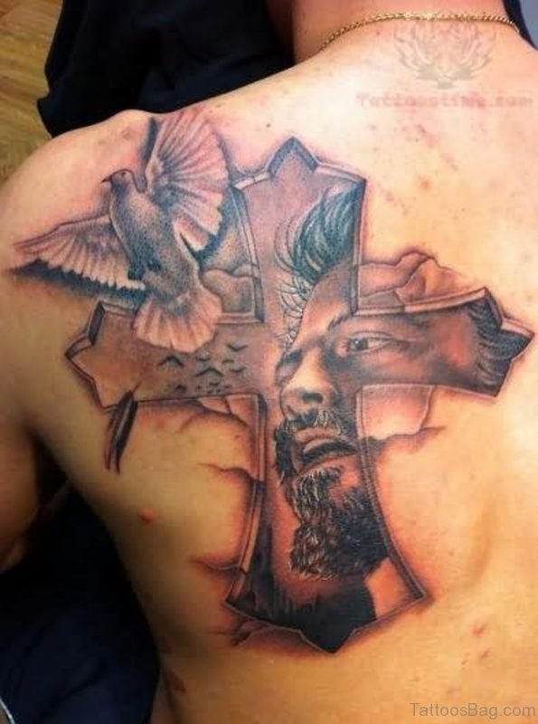 Cross And Dove Tattoo On Back