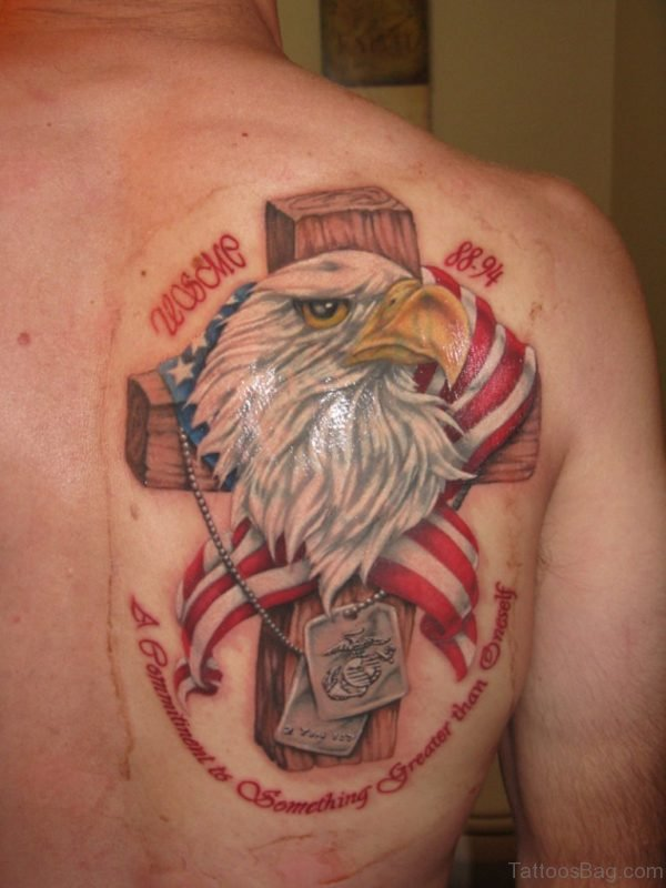 Cross And Eagle Head Tattoo On Back