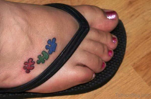 Cute Autism Tattoo On Foot