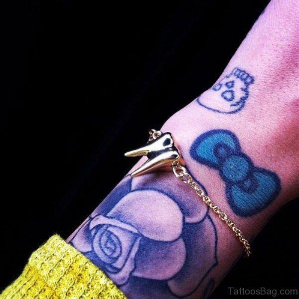 Cute Blue Rose Wrist Tattoo
