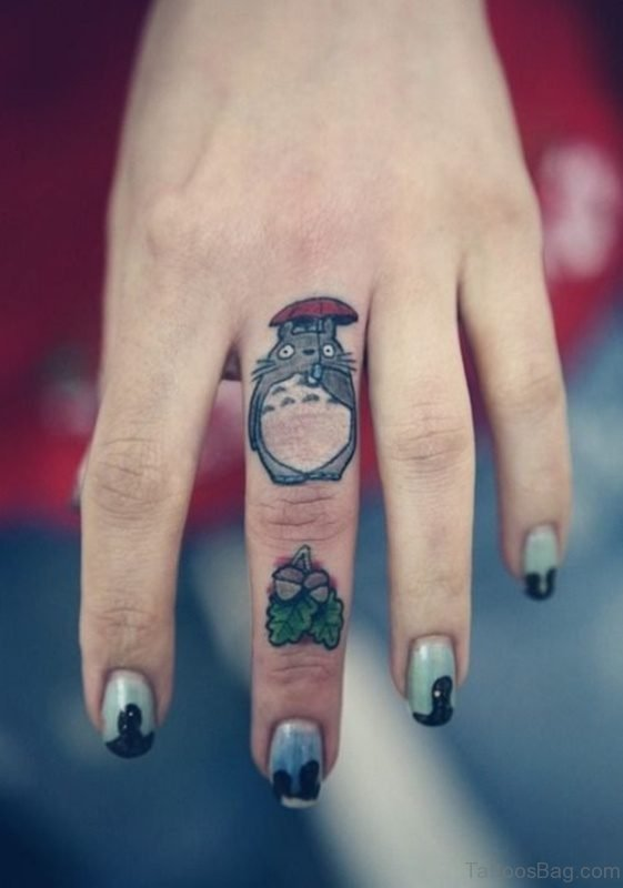 Cute Cartoon Tattoo On Middle Finger