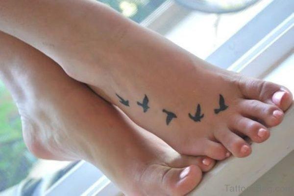 Cute Flying Bird Tattoo On Foot