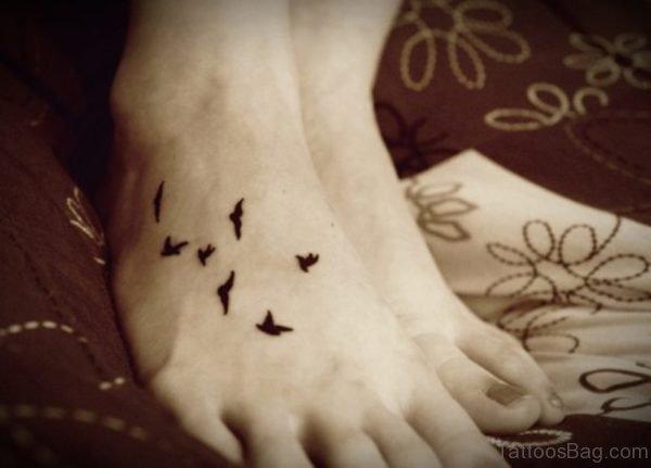 Cute Little Bird Tattoo On Foot