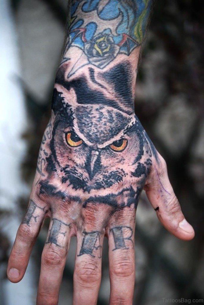 61 wonderful owl tattoos on hand. Black Bedroom Furniture Sets. Home Design Ideas
