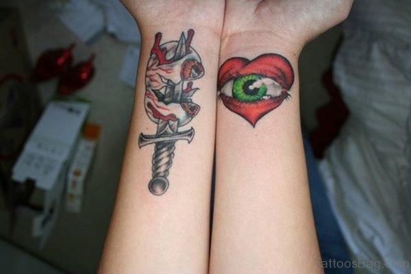 Dagger And Eye Tattoo On Wrist
