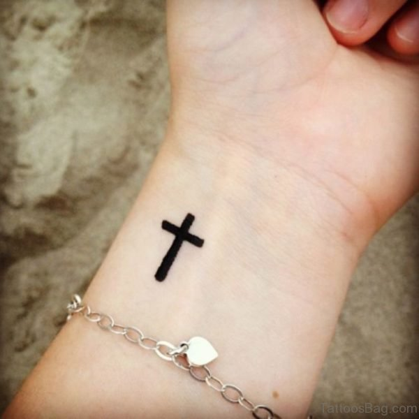 Dark Black Cross Tattoo On Wrist