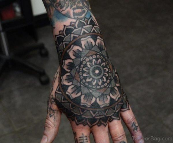 Dark Ink Mandala Flower Tattoo On Hand