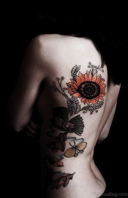 Dark Sunflower Tattoo On Rib