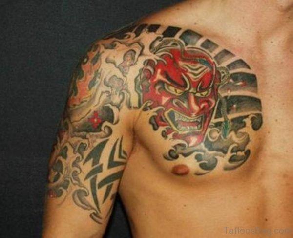 Devil Mask Tattoo Design On Chest