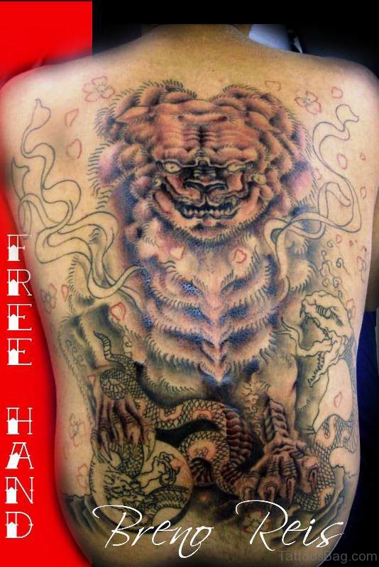 Dog With Snake Tattoo On Back