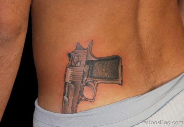 Eagle Gun Tattoo On Back Waist