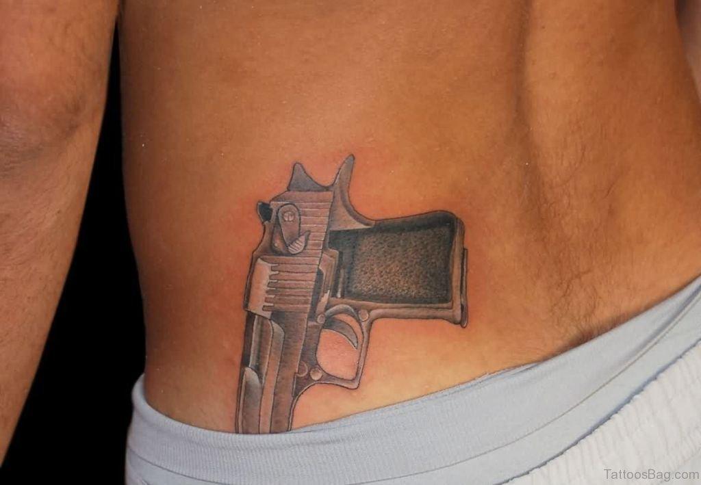 7a92806b6 71 Stylish Gun Tattoos For Waist