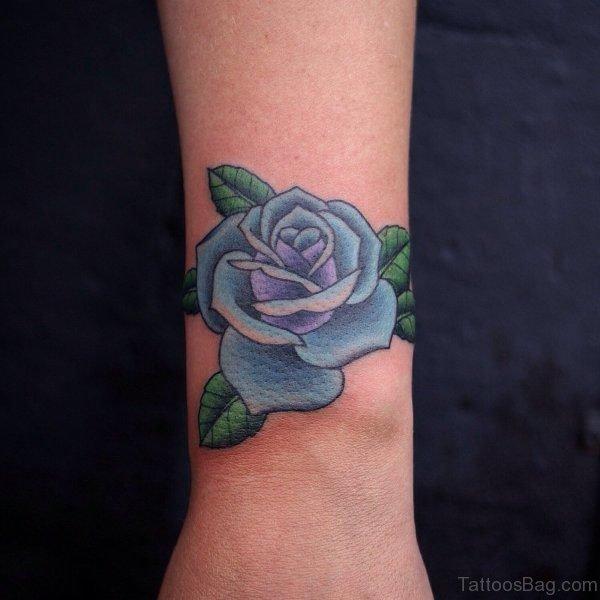 Elegant Blue Rose Tattoo On Wrist