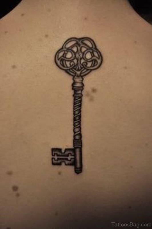 Elegant Key Tattoo On Back
