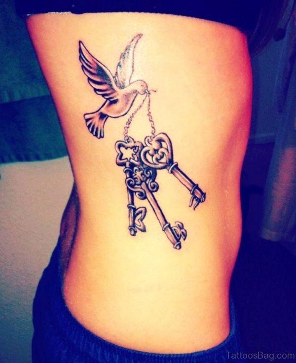 Elegant Rib Tattoo
