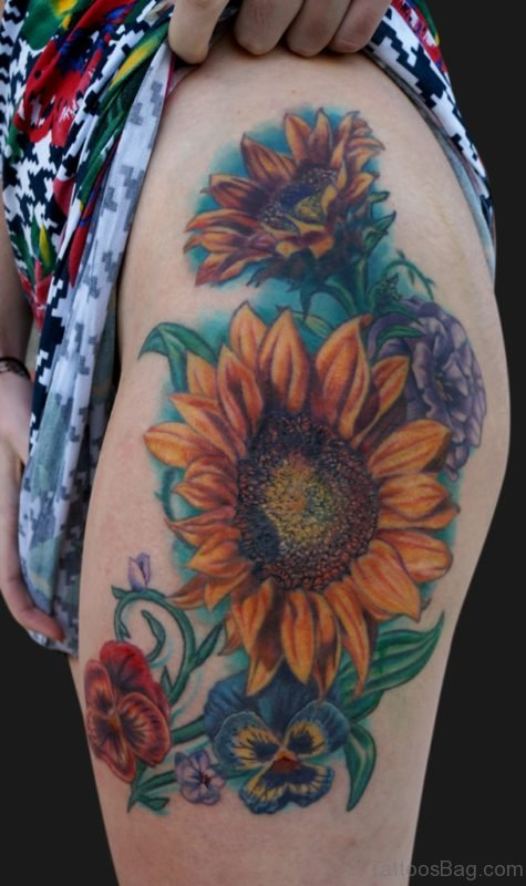 Elegant Thigh Tattoo