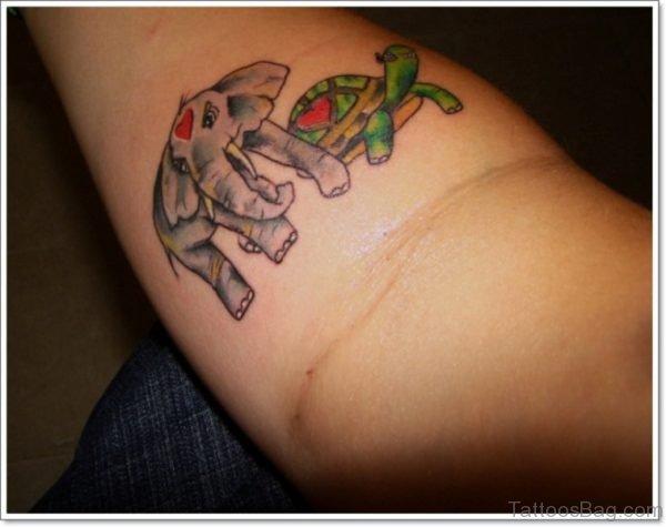 Elephant And Tortoise Tattoo On Forearm