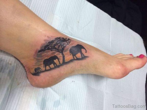 Elephant Family Tattoo On Foot