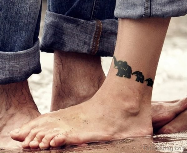 Elephant Herd Band Tattoo On Leg