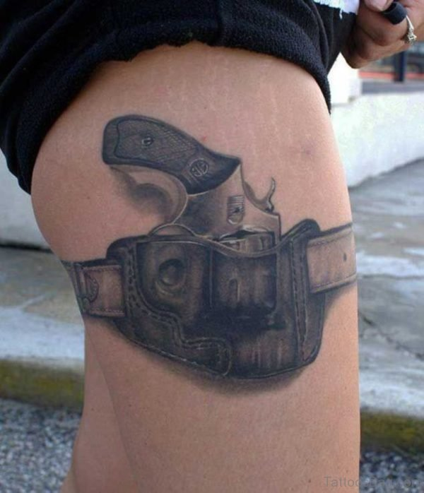Excellent Gun Tattoo On Thigh
