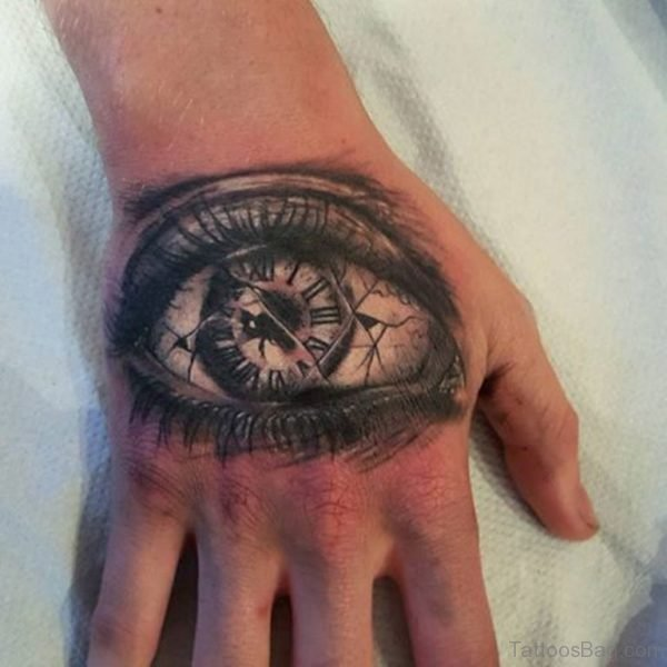 47 excellent clock tattoos for hand for Eye finger tattoo