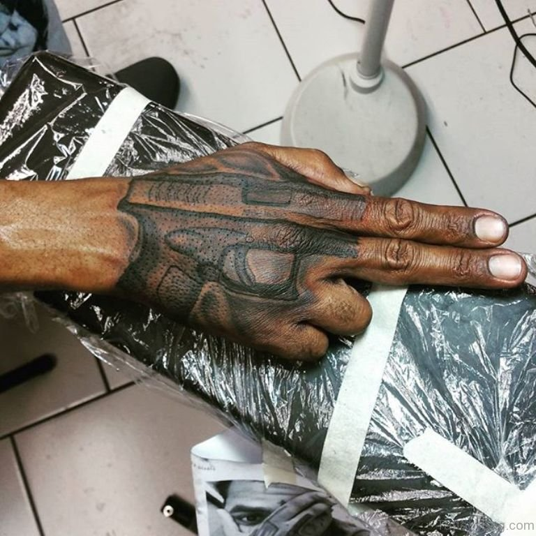 28 funky gun tattoos on hand