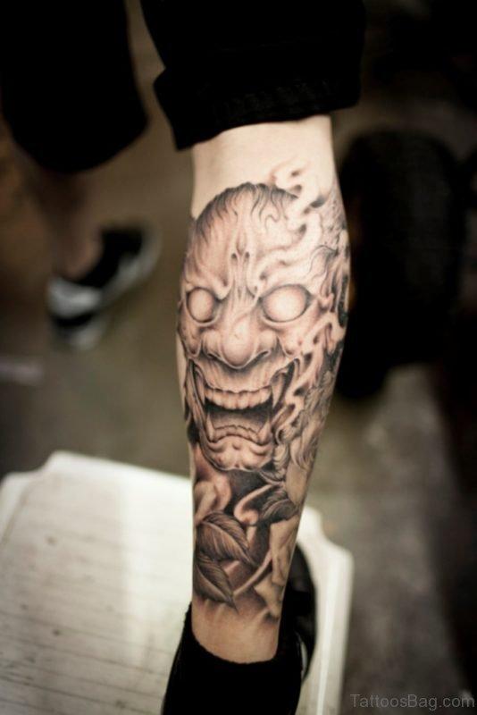 Fantastic Japanese Mask Tattoo On Leg