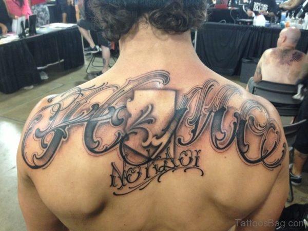 Fantastic Lettering Tattoo On Upper Back