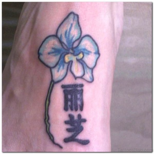 Flower And Chinese Letters Tattoo On Foot