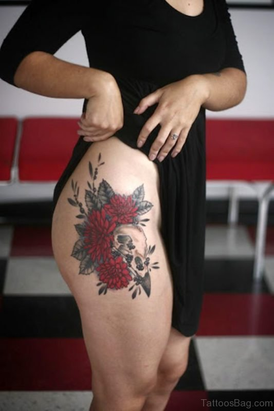 Flower And Skull Tattoo On Thigh