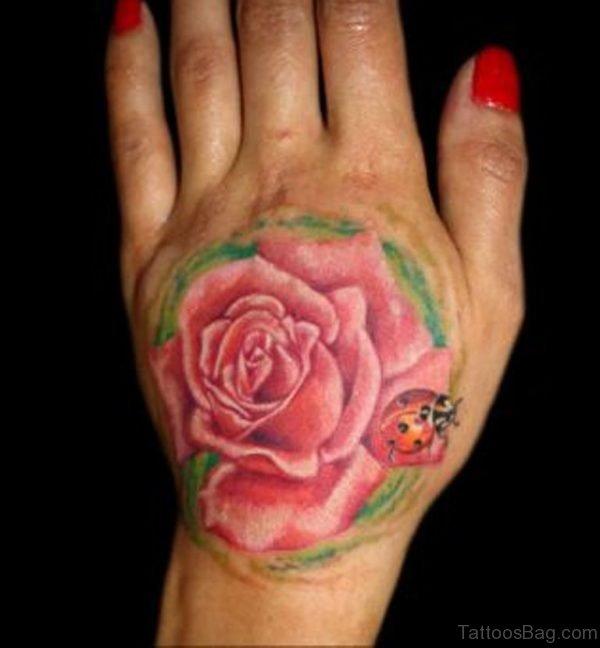 Flower Lady Bug Tattoo On Hand
