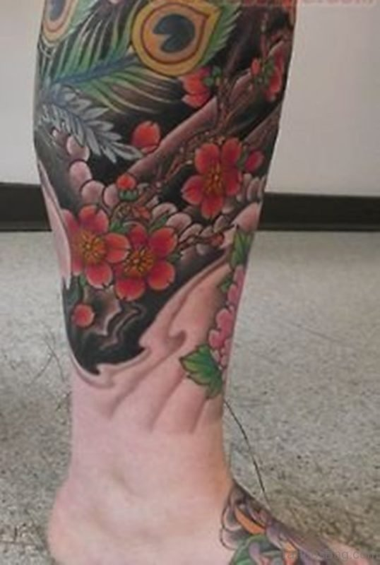 Flowers And Feather Tattoo