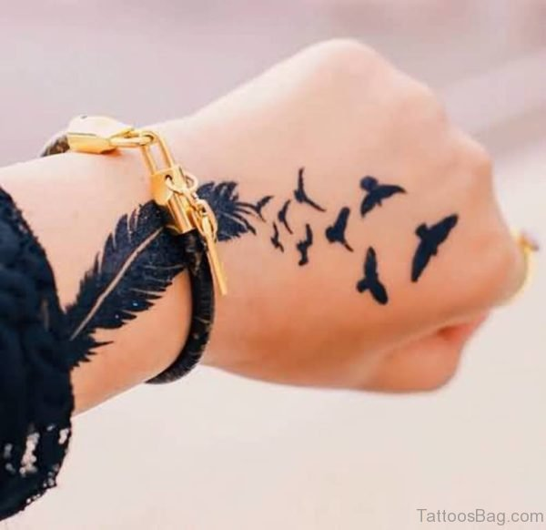 Flying Birds And Nice Feather Tattoo On Hand